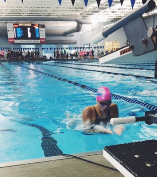 Hohm swims breaststroke at a swim meet for the Aquatic Team of Mecklenburg (ATOM).
