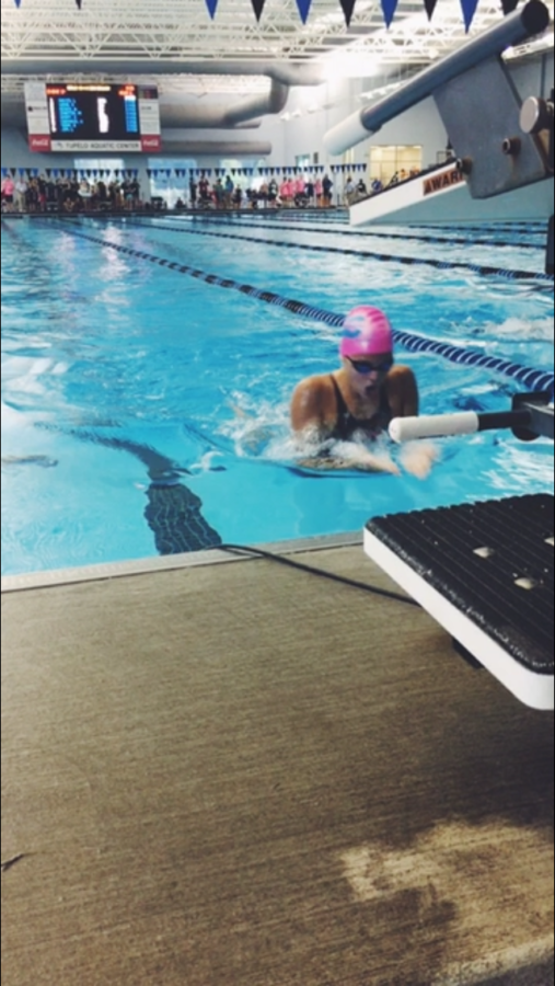 Hohm swimming in a competition