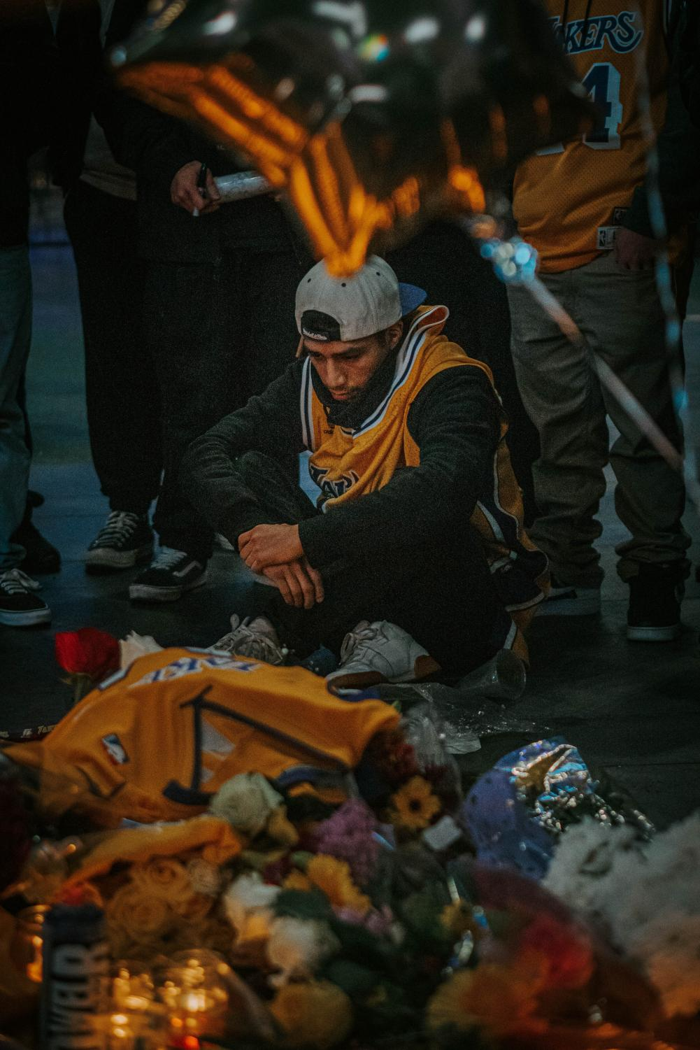 People in LA gather together in front of Staples Center to mourn the death of Kobe Bryant